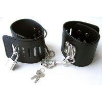 Регулирующаяся распорка с наручниками